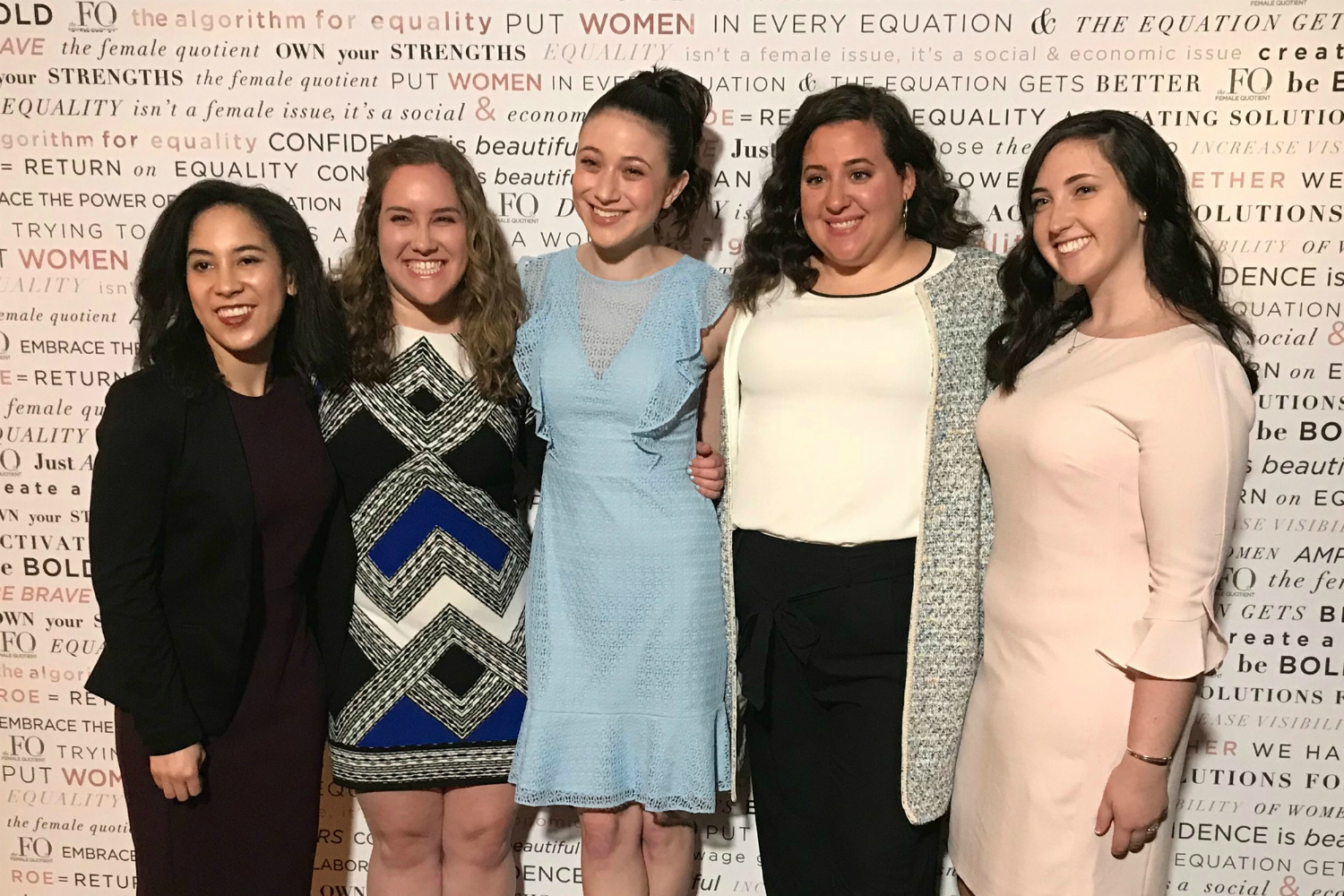 NYWICI scholarship recipients pose arm in arm