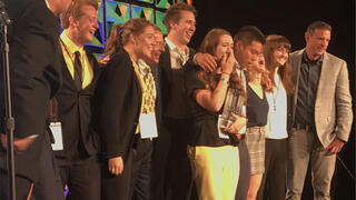 group of students winning award