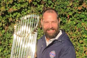 Josh Lifrak poses with World Series Commissioner's Trophy