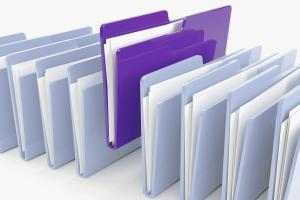 folders lined up with a purple folder slightly above the rest