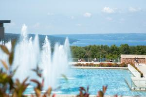 Dillingham Fountain on a sunny summer day with Cayuga Lake in the distance.