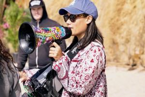 Alumna Aya Tanamura directing on an outdoor film set.