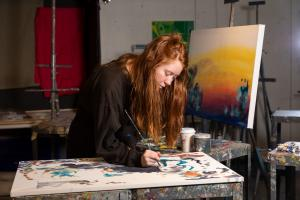 female student painting
