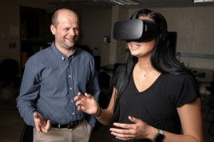 Student works with professor in virtual reality lab