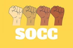 4 fists, different shades of brown skin tones, side to side, with the letters S O C C in white under them, on a yellow background.