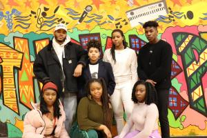 Group Photo of Black Student Union Students in front of spray painted wall