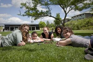 Students lounge on grass