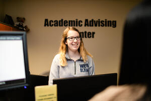 Student staffer at the Academic Advising Center.