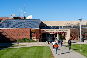 View of the Park School of Communications, students walking towards the front entrance