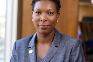 African American woman wearing a blue blazer