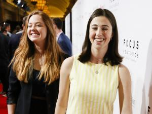 Clara Montague and Eva Kirie smiling at a red carpet event