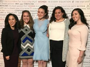 Five winners of the NYWICI scholarships pose arm in arm
