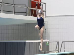 A woman jumps from a diving board
