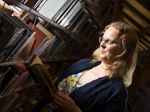 Katharine Kittredge does research in a library