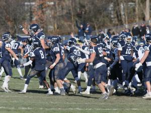 Ithaca players celebrate during the 2017 Cortaca Jug