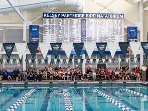 Sign above a swimming pool that says Kelsey Partridge BIrd Natatorium