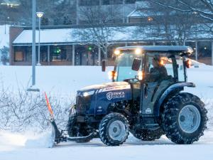 A tractor removes snow