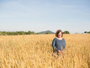 Amber Lambke in a field of grain