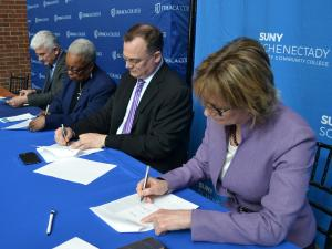 Provost La Jerne Terry Cornish and representatives from Ithaca College and SUNY Schenectady sign the agreement