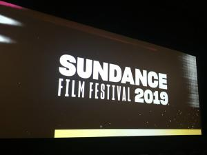 A movie screen with the Sundance Film Festival 2019 logo