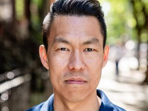 Headshot of Jack Wang on a leafy street
