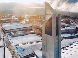 Aerial view of the A&E Center and a snow covered campus