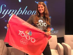 student with Olympics flag