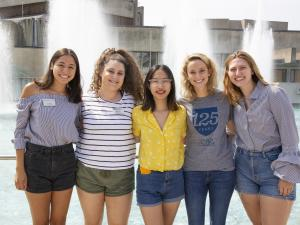 A group of students posing around a fountain