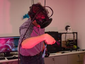 An individual with a virtual reality headset on.