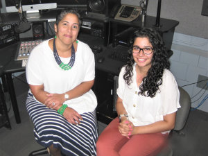President Shirley M. Collado and student Farwa Shakeel '20 sit in the WICB production studio.