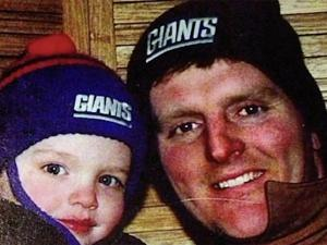 little boy and his father wearing Giants hats