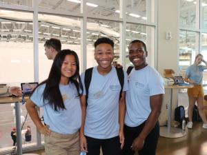 three orientation leaders at check-in