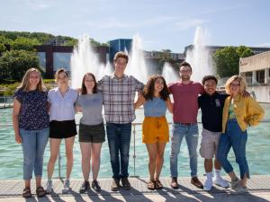 A group of students in front of the fountains.