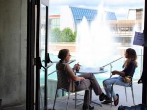 Scholar and Mentor discussing in front of the Fountains