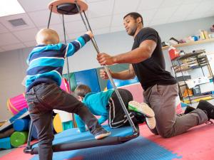 Occupational therapist student works with children