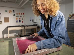 Olivia Carpenter works on her screen printing