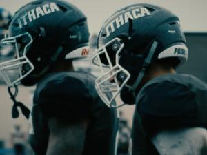 Two Ithaca College football players in blue helmets.