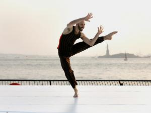 dancer in front of statue of liberty