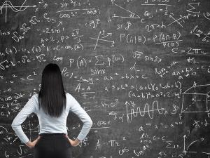Woman Standing at Chalkboard