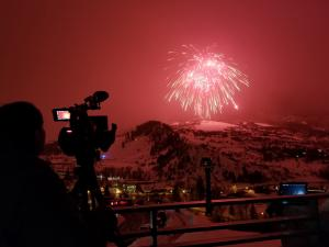 person filming fireworks