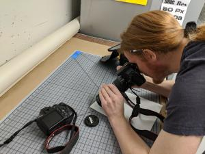 student using camera to take a close up shot
