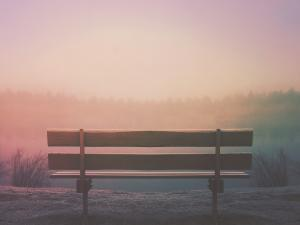 Bench overlooking sunset Photo by Aaron Burden on Unsplash