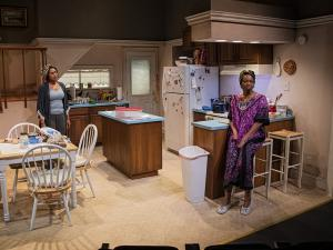two women in a kitchen in a play