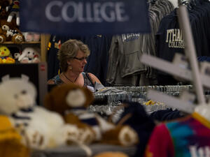 Woman browses college-branded merchandise.