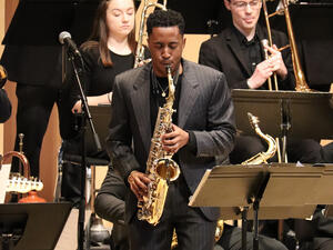 Student playing a saxophone