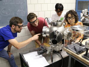 Chemistry and physics collaboration in a lab.