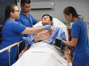 students with a patient care manikin