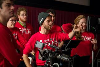 Students in red shirts use a Red camera