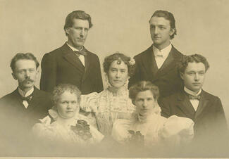 Black-and-white portrait of seven people.