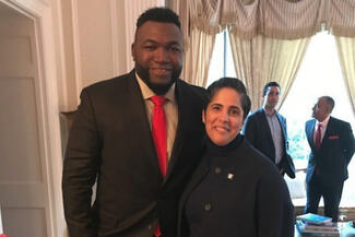 Shirley M. Collado and David Ortiz pose for a photo